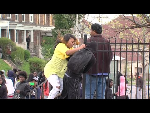 ORIGINAL: Angry mother beats son for participating in Baltimore riots