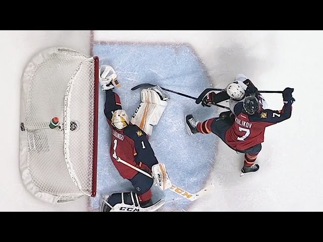 Luongo extends arm for superb glove stop