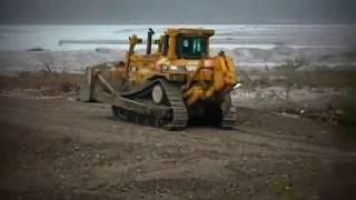 Caterpillar D9N Dozer Pushing gravel in the river