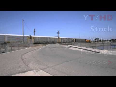 Freight Train on Daily Route Schedule Backing Up w/ Cargo Container Cars | HD Stock Video Footage