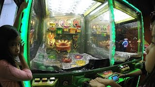 Raptor Captor Arcade Ticket Redemption Game At Dave & Buster's: 4 Kids Play A Ball Shooting Game