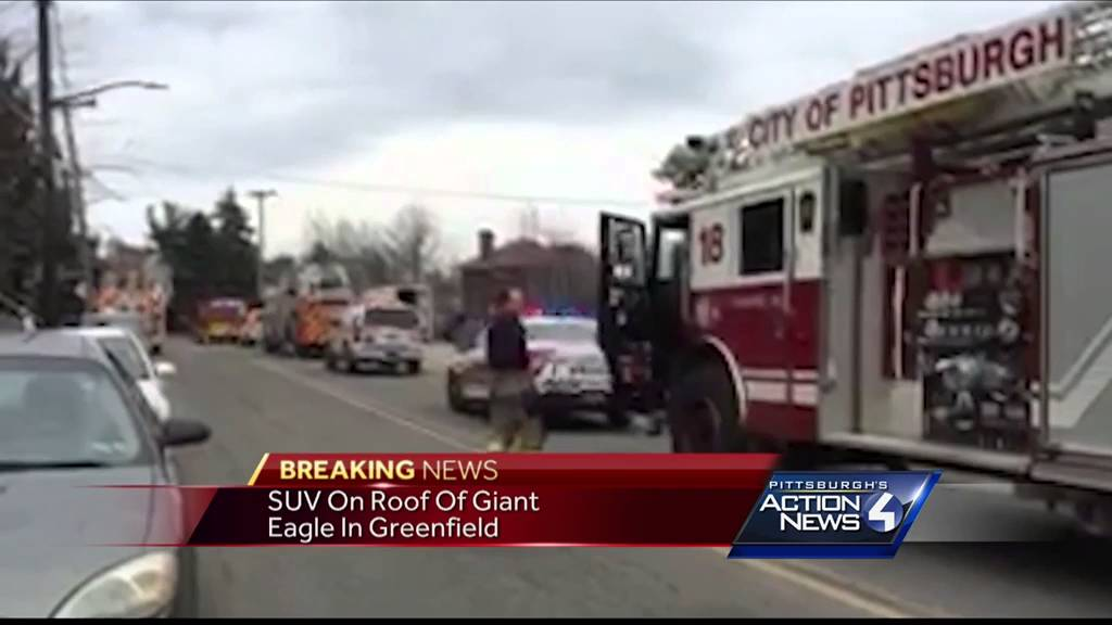 Suv Crashes Onto Giant Eagle Roof In Greenfield Youtube