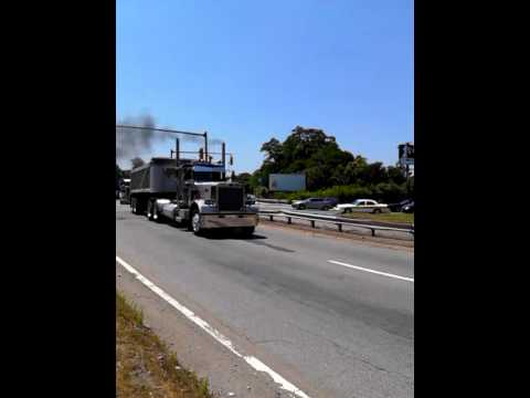 Convoy of trucks going through  Bell Circle in Revere,MA