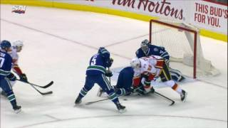 Tanev leaves game after taking hit from deflecting puck