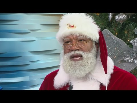 'Black Santa' Helping Spread Christmas Cheer At MOA