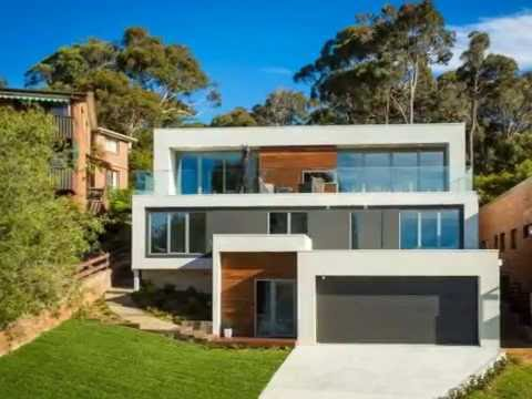 Modern home design with contemporary style build on for Home designs for sloping blocks