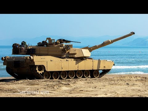 Here's What Happens to an Abrams Tank if Hit by a Battleship Shell