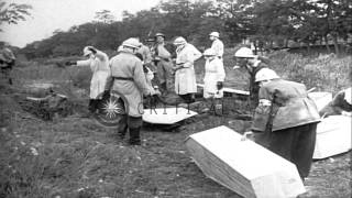 Dead bodies of soldiers killed by Nazis are exhumed from a mass grave and placed ...HD Stock Footage