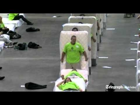 Human mattress dominoes attempt breaks world record