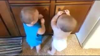 Two Kids Playing With Rubber Loops At Closet Door