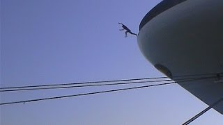 Repeat youtube video Crazy man jumps off cruise ship