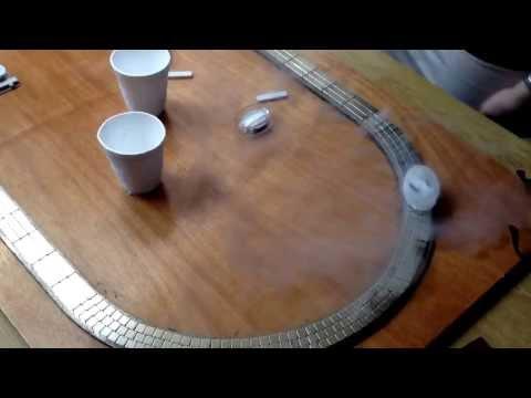 Liquid nitrogen cooled superconductor levitating on a magnetic track