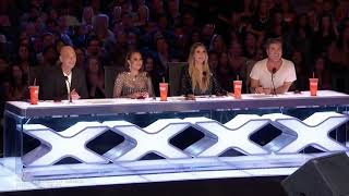 STUNNING singing audition moves Simon Cowell Stunning singer gets golden buzzer