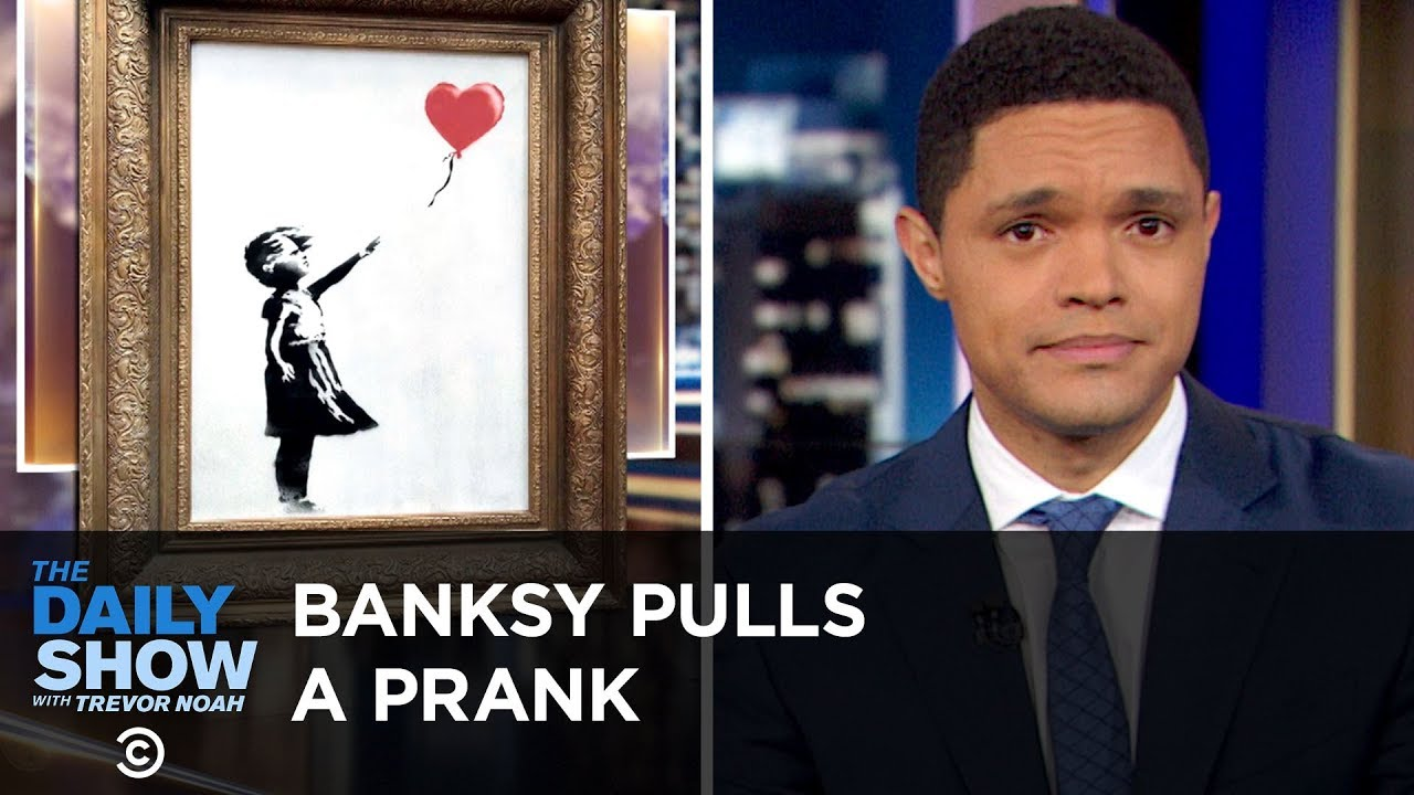the-u-n-issues-an-alarming-climate-report-banksy-shreds-his-painting-the-daily-show