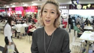 Marissa eating at New World Mall food court