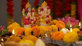 Diwlai Puja - Flower showering to Indian God Ganesha and Lakshmi idol / murti