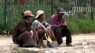 Bhutanese sitting on footpath in Bumthang, Bhutan
