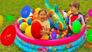 Huge Eggs Surprise Toys Challenge in Kids Pool filled with Balls! Outdoor Play