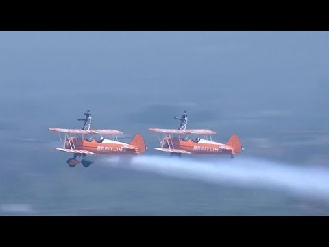 Acrobats thrill with wing-walking performances at Zhengzhou air show