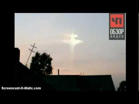 Sign from God ?  Crucified Jesus Appears in the Sun Russia ! Miracle ?