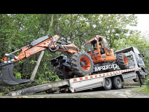 Spider Excavator Transport By Quester Self Loader Truck Euromach R145