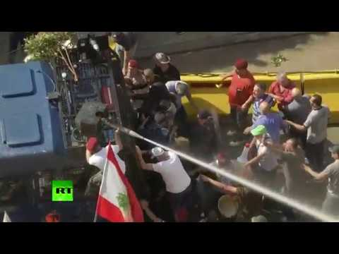 Protesters take over water cannon while attempting to storm PM's office in Beirut, Lebanon