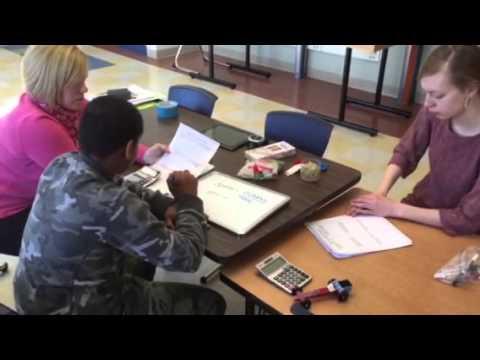 Elmira College students teach lessons in Beecher Elementary School in Elmira, New York