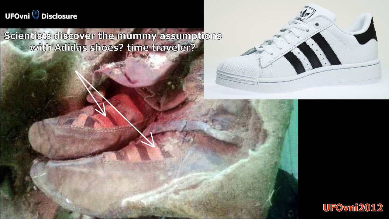 womans adidas trainers on mummy