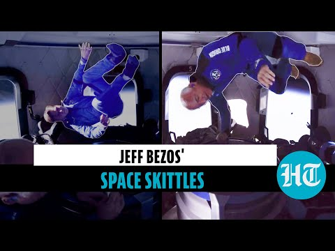Watch: Jeff Bezos floats in space shuttle, passes Skittles in zero gravity | Blue Origin
