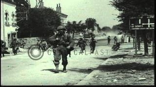 Infantry and military tanks advance through Mayenne and fire at the Germans acros...HD Stock Footage