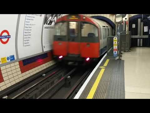 3 London Underground tube trains, Picadilly Circus Station. Piccadilly Line going northbound