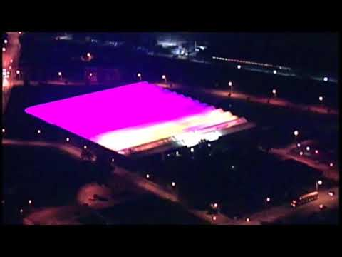 From above: Green City Growers Greenhouse give off a purple light in the sky