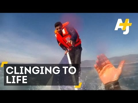 Dramatic Footage Shows Refugee Clinging To Capsized Boat In Aegean Sea
