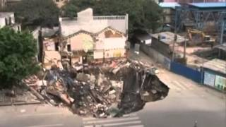 Sinkhole swallows whole building complex in China