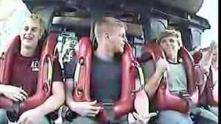 funny boy on roller coaster