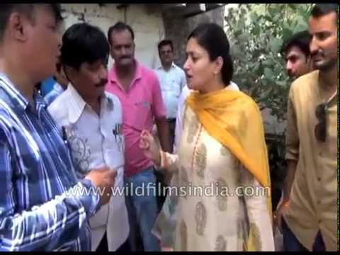 Indian politician falls into dirty sewer