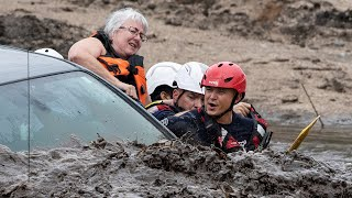 video: Watch: Moment woman rescued from car in flash flooding in Arizona