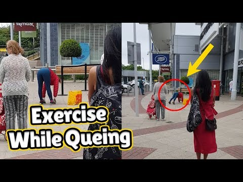 Woman Performs Exercise Routine While Queuing At The Supermarket