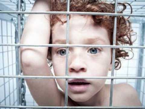 Caged naked boys