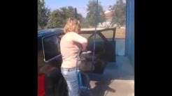 Woman Washes Car with doors open