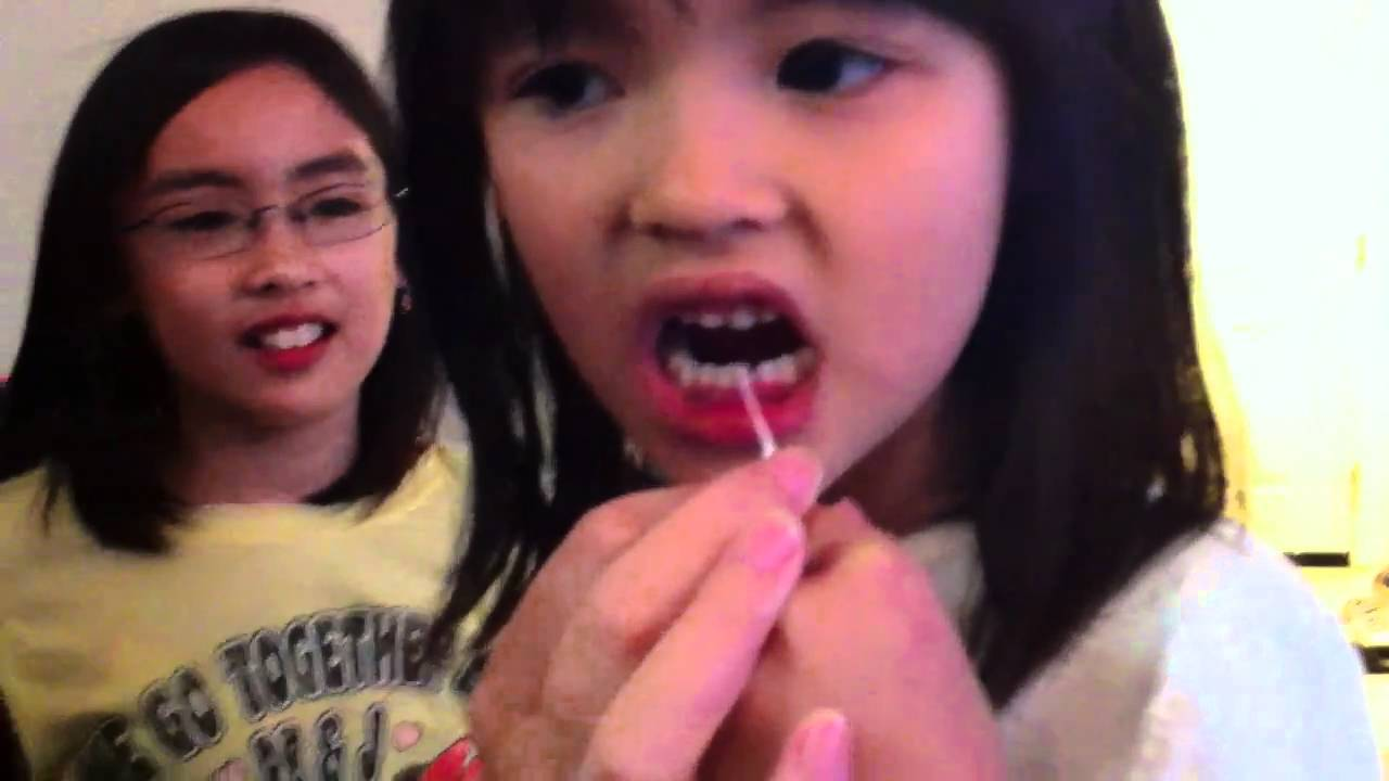 how to make your loose tooth come out without pain