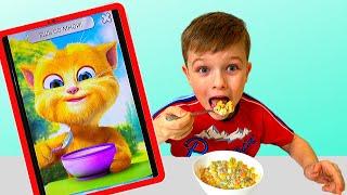 Андрей с смешным котом кушают и играют