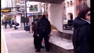 San Diego Transit Police take a woman off of the trolley and handcuff her
