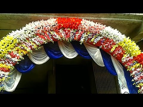 entry-gate-decoration-with-multicolour-artificial-flowers-&-colourful-silk-curtains-in-wedding-party