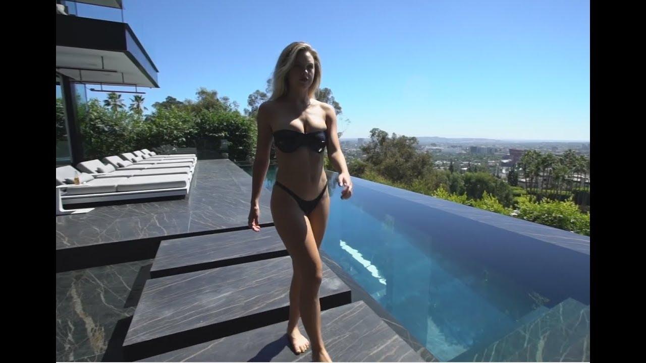 20 modelos de piscinas modernas com vidro nas laterais ou