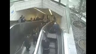 Moment an escalator collapsed and swallowed a man falling through hole at busy underground station
