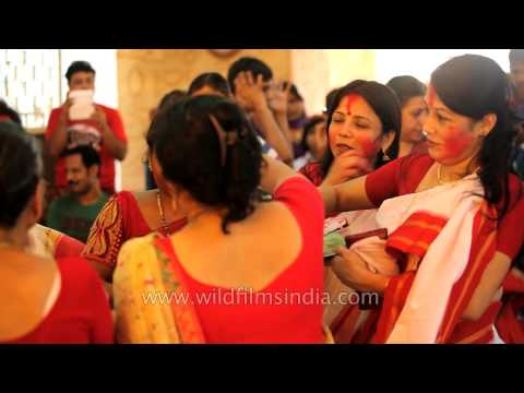 Married Indian women in ritual of Sindur khela: Kolkata Durga puja