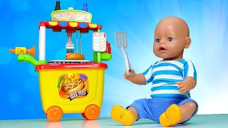 Pretend to play cooking hot dogs with Baby Dolls! Funny videos for kids with food toys for kids.