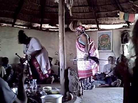 Sangoma dancing and singing and drumming