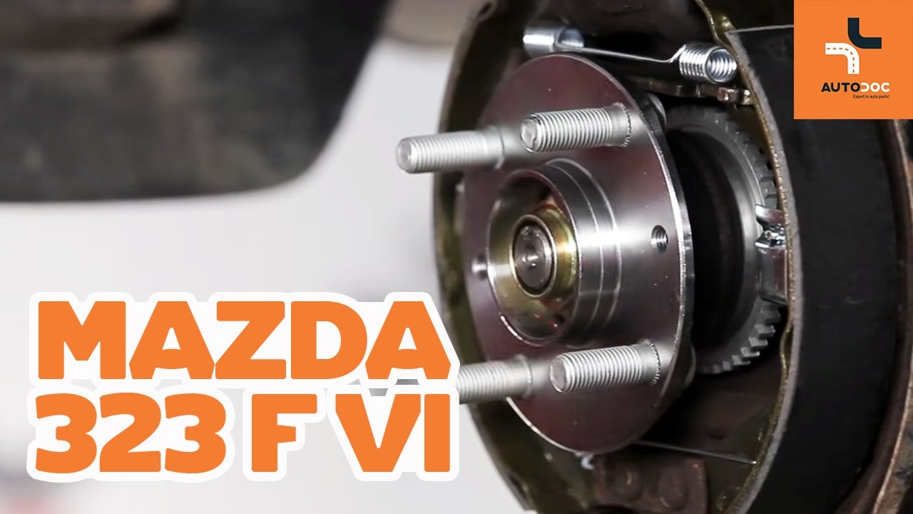 how to replace a rear wheel bearing on mazda 323 tutorial autodoc [ 1280 x 720 Pixel ]